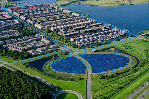 Green self-sufficient energy supply houses in residential area with solar panels
