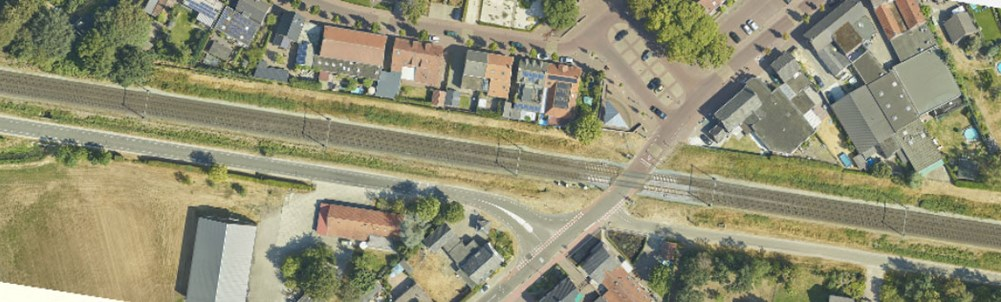 An aerial photograph of the railway track in the village of America, Limburg, where the construction of solar panels on noise barriers along the road track will be built.