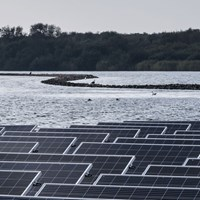 An overview of floating solar panels on the water surface of the Oostvoornse lake, The Netherlands.