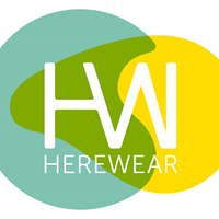 Logo of the European HEREWEAR project: a sea green, green and yellow colored oval shaped surface with the letters HW and HEREWEAR in it