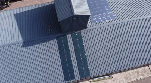 Lightweight flexible roof elements with solar cells on a stable of a farm at Hoevelaken.