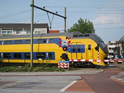 Rail traffic in Vught on the railway 's-Hertogenbosch-Eindhoven